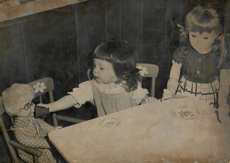Susanne when she was 2 years old playing tea party with her Mrs. Beasley doll