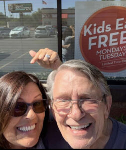 Me and Susanne in front of a Kids Eat Free sign.